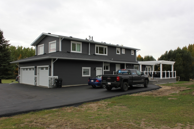 After Photo - Addition - Hardie Board Siding - Garage Doors - Soffit & Fascia - Windows