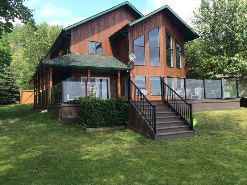 Frame less Glass Railing -  Aluminum Railing -  Clubhouse PVC Decking -  Clubhouse PVC Stairs -  Composite Skirting -  Wrap Around Deck